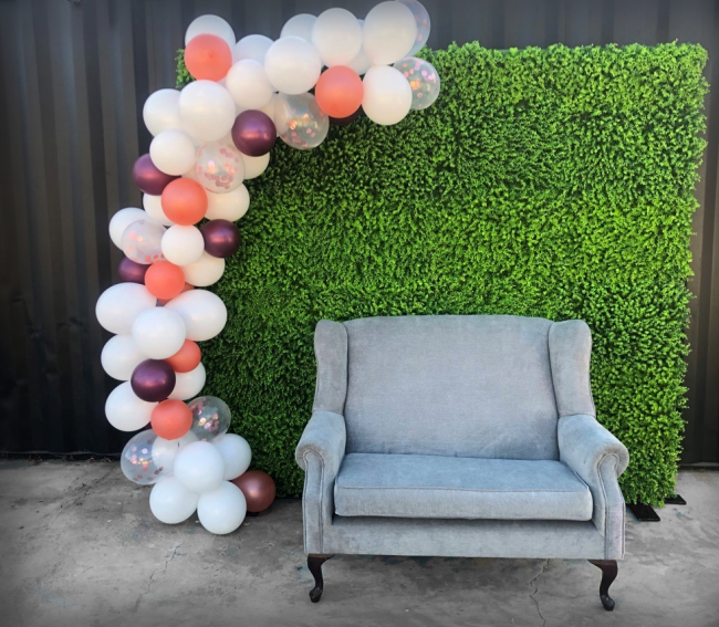 hedge-wall-with-balloons-and-couch