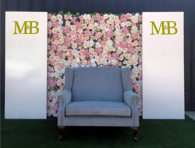 silk-flower-wall-with-panel-and-couch