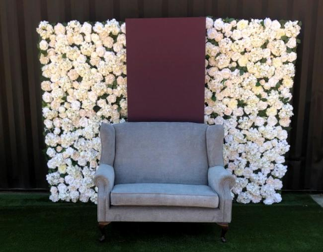 silk-flower-wall-with-panel-&amp-couch